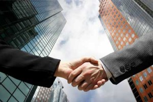 Mergers & Acquisitions Handshake - Franchise Help