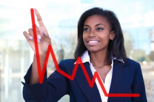 Minority Franchise Owner - Woman at Stock Chart - Franchise Help