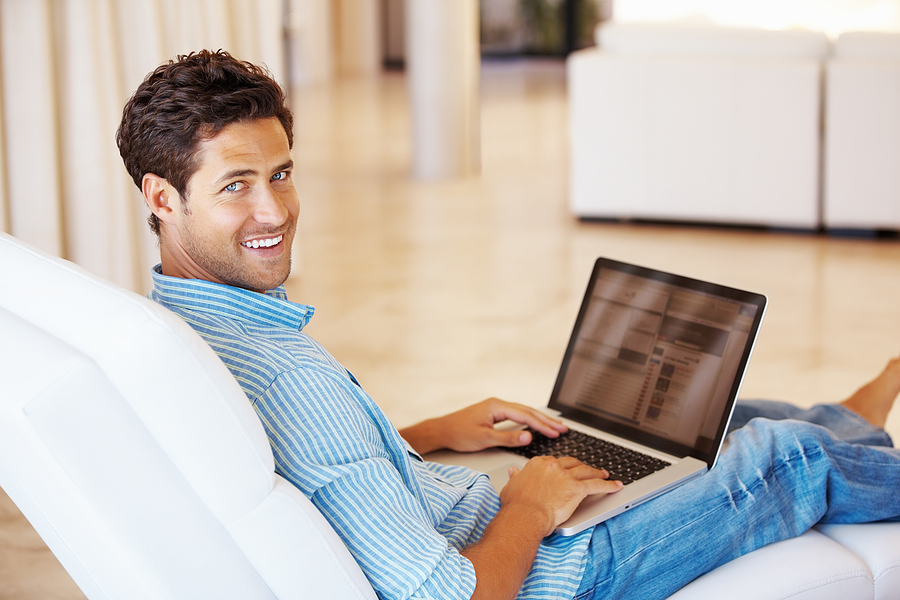 Man sitting at computer on couch
